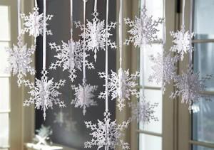Украшение дома снежинками